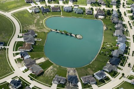 The curving streets of a suburban housing development