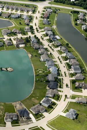 An aerial shot of a neatly manicured subdivision.