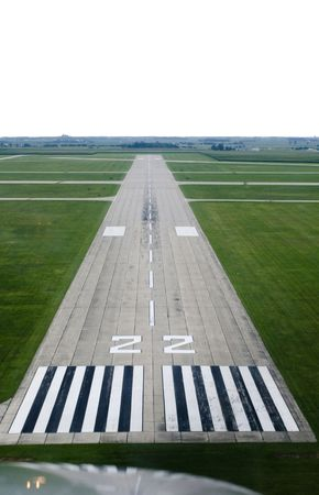 Looking down the runway of a rural airport. 免版税图像