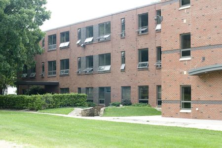 dorm: An exterior shot of a brick dormitory building.   Stock Photo