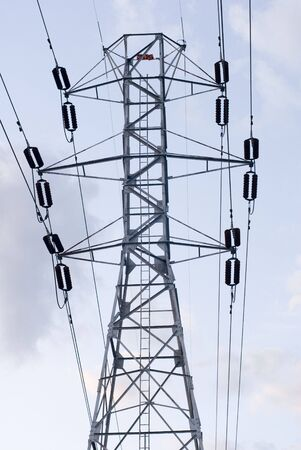 Tall, metal electric pole photographed during the day  photo