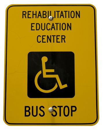 Yellow bus stop sign with handicap symbol