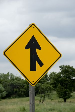 accommodate: Single yellow and black merge sign Stock Photo
