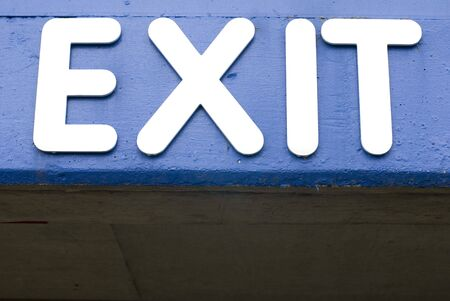Closeup of a blue and white exit sign Stock Photo - 3609620