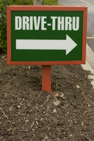 drink and drive: Green and white plastic drive-thru sign in the ground Stock Photo