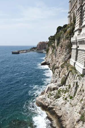 oceanographic: A view directly outside of the Oceanographic Museum down the long, rocky coastline of Monaco.