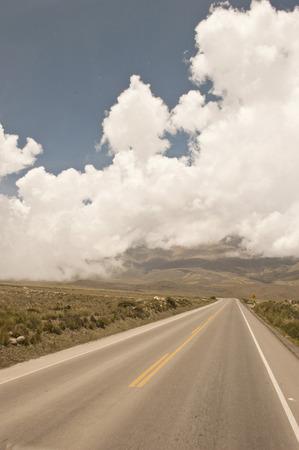 roadway: A Peruvian roadway near Arequipa Peru in the Yura district on a cloudy day.