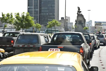 Traffic in Lima, Peru on a sunny day of a taxi in traffic.