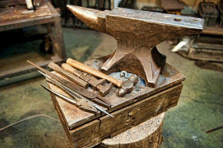 fabrication: A set of metal fabrication tools along side an anvil in a metal fabrication shop. Stock Photo