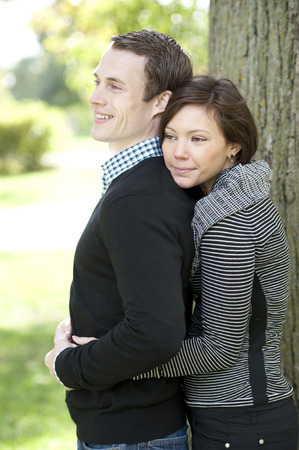 room for copy: A young and happy couple looking to the left with room for copy space. Stock Photo