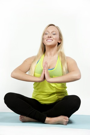 dhyana: Young female model showing the self inquiry meditation pose in yoga - also known as Dhyana.