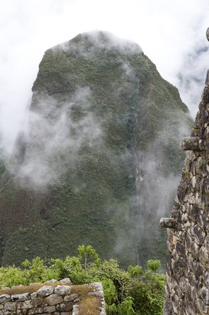 machu picchu: A view from Machu Picchu on a cloudy day.
