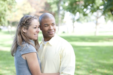 interracial couple: A happy young interracial couple looking to the right side
