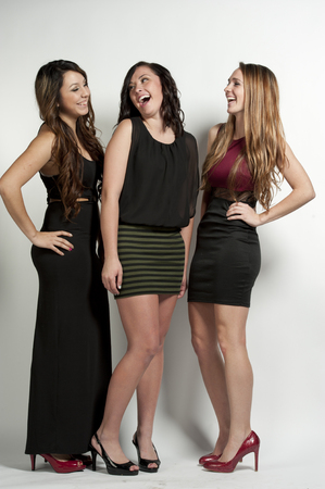 white women: Happy young girls posing on a white background in a studio.
