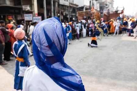 punjab: Several local Sikh people including both men and women gathering to offer prayer in front of a religious march in Delhi. On the background, the religious ceremony is seen.