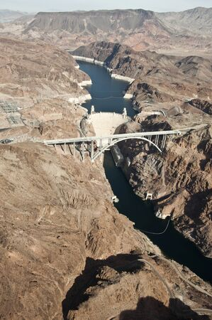 hoover: A high-top view of a Hoover Dam going across a river in the Grand Canyon.