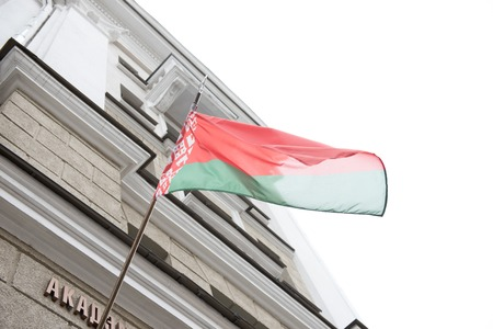 properous: National flag of Republic of Belarus waving from an administrative building on a breezy morning. Belarus is a Republican country and is one of the most properous nations across Europe.