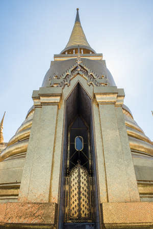 dazzle: View of the Phra Sri Rattana Chedi built in Sri Lankan design at the Grand Palace in Bangkok. The Golden color of the building makes it dazzle like pure gold during the sunlight. Stock Photo