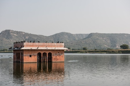 rajput: Jal Mahal on the Man Sagar lake in Jaipur, Rajasthan. Built infusing Mughal and Rajput architecture, this palace looks stunning with Aravalli hills on the background.