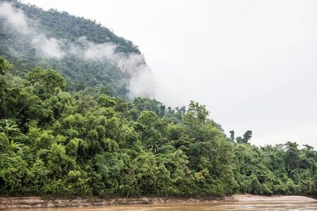 unmatched: Mountain Phou Si on the Mekong river. The lush green forest covers it like green blanket. The view from Mekong river is jaw-dropping and delivers unmatched cruising experience.