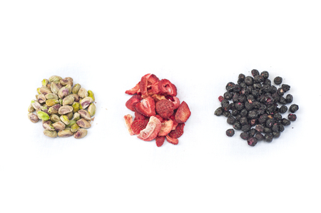 Pistachios, freeze dried strawberries and blue berries prepped for baking.