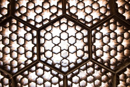 lattice window: Intricate architectural details inside the Amber Fort in Jaipur, Rajasthan. Lattice windows, crafted magnificently inside Ganesh Pol complex in the fort is seen.