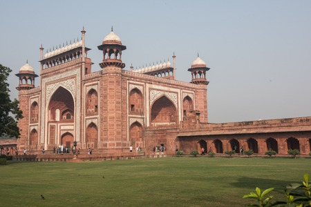 mughal empire: View of the famous Darwaza-i-rauza or the Great Gate inside Taj Mahal at Agra, Delhi. It is the entrance to the tomb in Taj Mahal. The lush green garden is seen too.