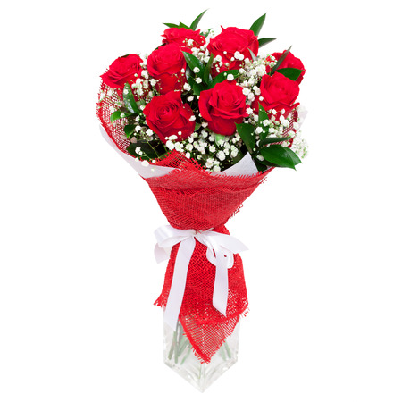Bouquet of bright red roses in a glass vase isolated on white background. Great present for a valentine