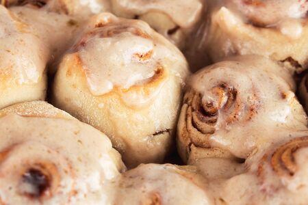 Sweet delicious homemade cinnamon rolls. Shallow depth of field Фото со стока
