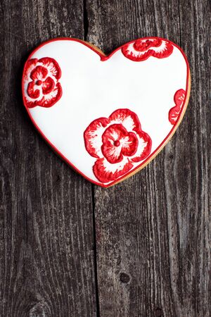 Valentine heart dessert cookie on rustic wood. Sign of love for a loved one on a valentine's day. With empty space for text.