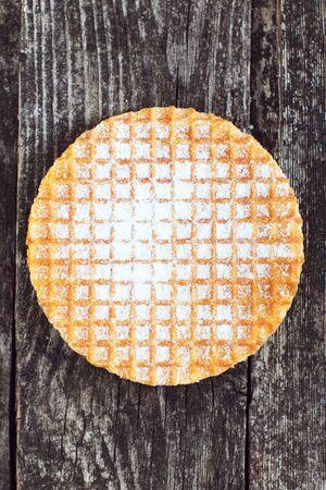 Waffle stroopwafel on rustic wood. Delicious breakfast sweet food