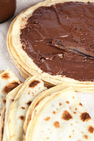 Pancakes crepes with chocolate for breakfast. Tasty morning food