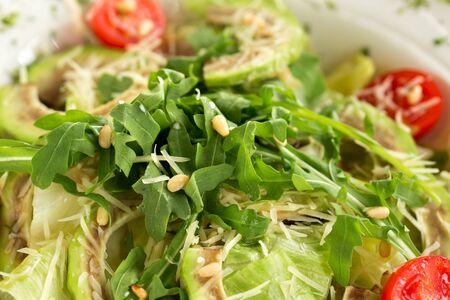 Salad with avocado and arugula macro. Healthy salad recipe Фото со стока