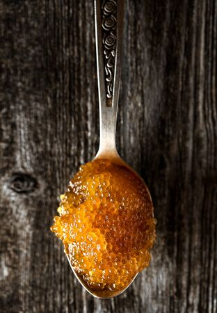 Spoon with delicious caviar of pike fish top view