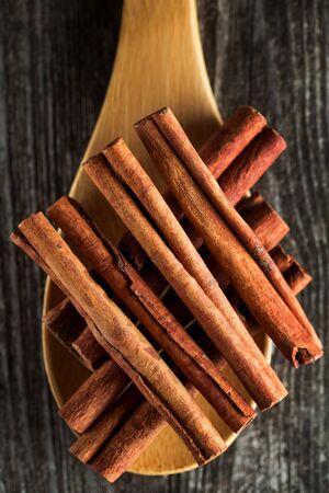 Cinnamon sticks spice on rustic wooden background Фото со стока