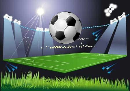 Voetbal bal op het veld van het stadion met licht