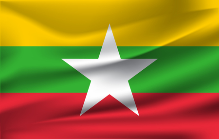 Flag of Myanmar. Realistic waving flag of Republic of the Union of Myanmar. Fabric textured flowing flag of Burma.