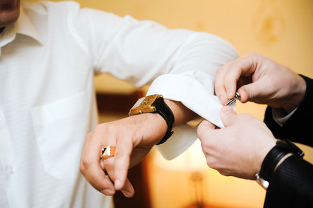 cuff link: A Groom is preparing for wedding Stock Photo
