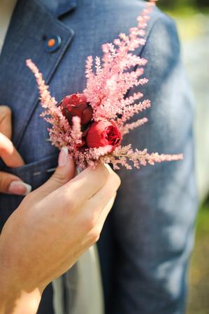 pinning: Pinning a Boutonniere