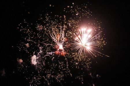 panoply: Cluster of colorful fireworks against dark sky Stock Photo