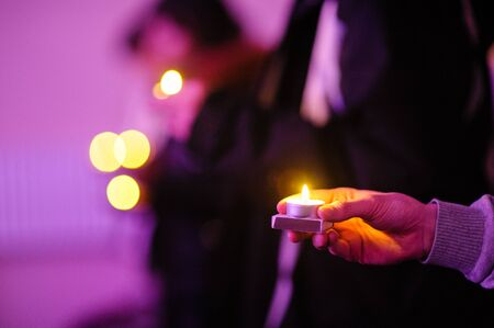 hope symbol of light: Hand holding candle light. Symbol of hope, peace and love