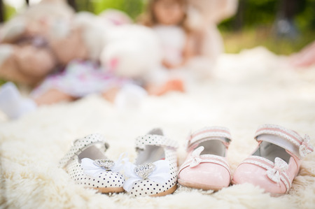 Baby shoes for a two girls summer outdoor Stock Photo
