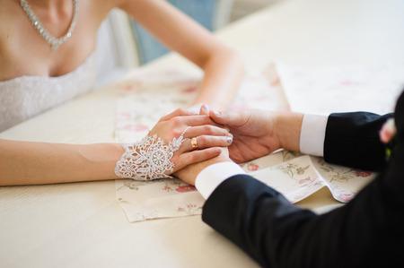 Bride and grooms hands at wedding ceremony Reklamní fotografie