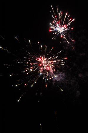 panoply: Cluster of colourful fireworks against dark sky Stock Photo