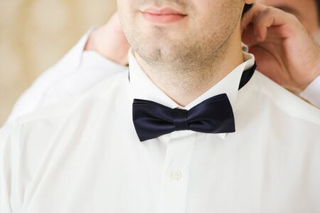 Groom is preparing for his wedding at morning photo