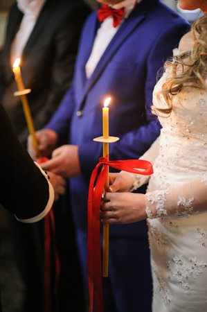 messa: groom and bride in orthodox christian church