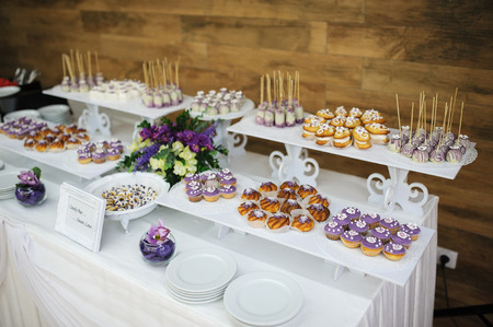 sweet tart: wedding dessert with delicious cakes and macaroons
