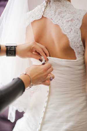getting a bride: bride getting dressed on her best day ever