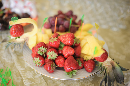 nice looking and tasty pineapple and strawberry on wedding reception