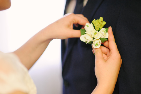 pinning: Pinning a Boutonniere for groom on his wedding Stock Photo